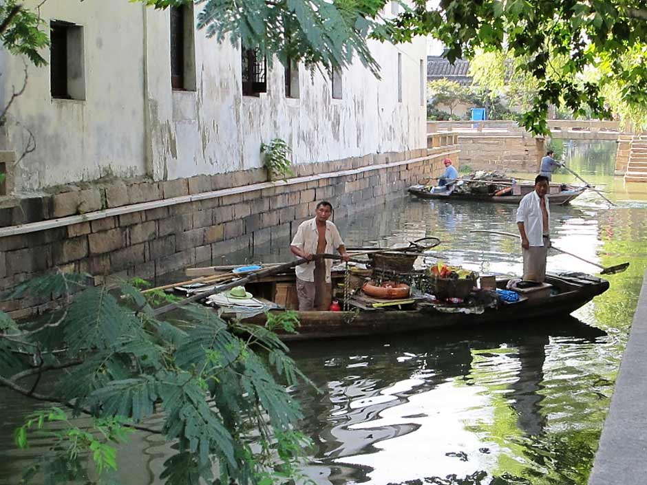 Suzhou, garbage cleaners on canal